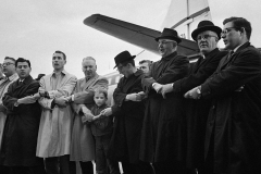 """Rabbi Richard A. Hirsch, second from left, and a group of clergymen from the Washington area join hands to sing """"We Shall Overcome"""" at Washington National Airport on March 8, 1965 before flying to Alabama to take part in a scheduled march on March 9 for Negro voting rights."""