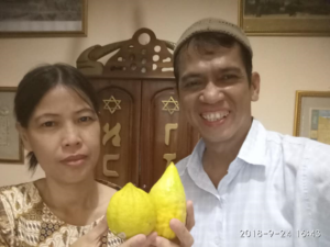 Comparing a locally grown etrog (left) with Israeli imports in Indonesia.