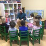 Pavel Kachkin with children celebrating Tu BShvat at Shaarei Shalom in St Petersburg, Russia