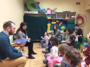 Pavel Kachkin and Alla Mittelman learn about Tu Bsvhat with children at Shaarei Shalom in St Petersburg, Russia